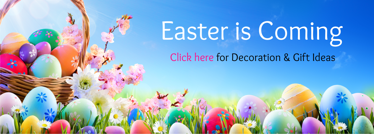 Easter Banner with coloured eggs in a wicker basket sitting in a grass meadow with blue sky